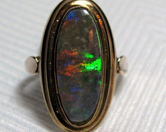 Multi-color Play of Color 18.9 x 7.70mm Boulder Opal Ring 8K Yellow Gold Size 7.5