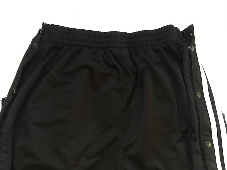 c530c093afb8a 1990s ADIDAS TRIPLE STRIPE Distressed Vintage Snap Pant Wide Leg Fit //  Size Large