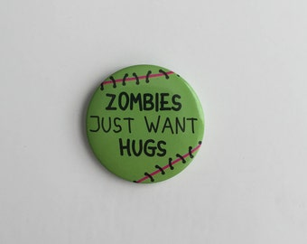 Zombies just want hugs 1 1/2 in button