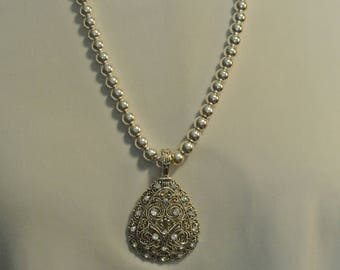 A Very Nice Silver Bead Necklace with a Large Pendant and Earrings