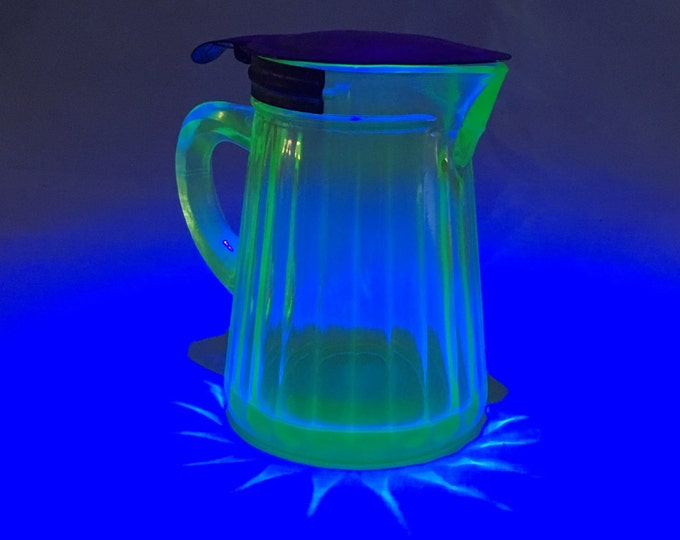 Vertical Ribbed Depression Vaseline Glass Syrup Pitcher with Spring Hinged Lid Patented Aug 22nd 1916
