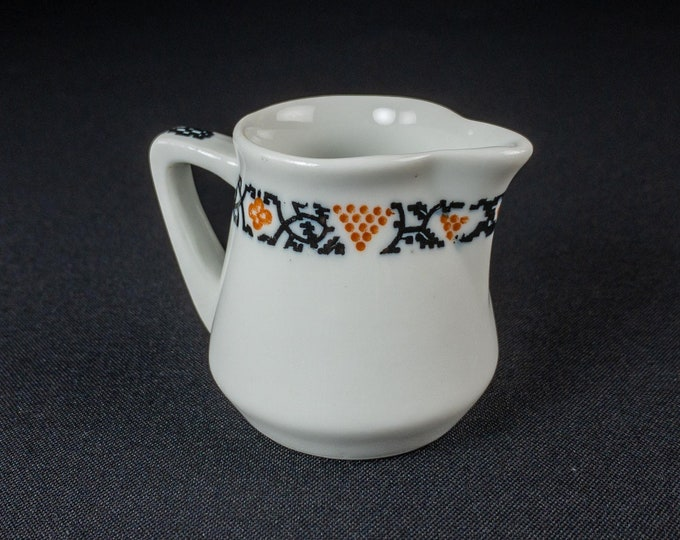 "1930s Restaurant Ware Handled Creamer Orange Black Design 2 1/2"" H By Warwick China"