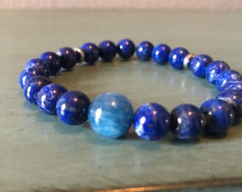 Beautiful Premium Quality untreated Lapis Beaded Bracelet (8mm) with A Quality Blue Kyanite 10mm focal bead.  Free Shipping in US