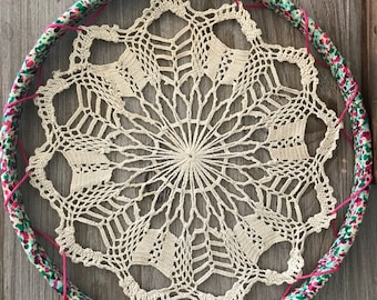 Vintage Tan Doily Wall Decor with Pink, Blue, and Green Fabric