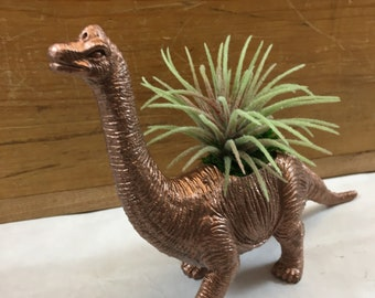 Hand Refinished, Repurposed Toy Dinosaur Planter (plant not included) . Charming gift for family , friends or to keep for yourself.