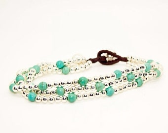 Silver And Turquoise Beaded Multi-strand Bracelet - on wax cord with bell finish