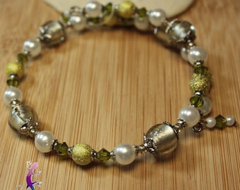 Bracelet with silver foil lampwork glass beads and green stardust beads