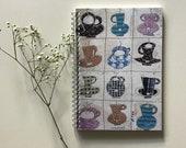 Notebook mugs, home decor, stationery, Montse Roldos artworks /Llibreta tasses
