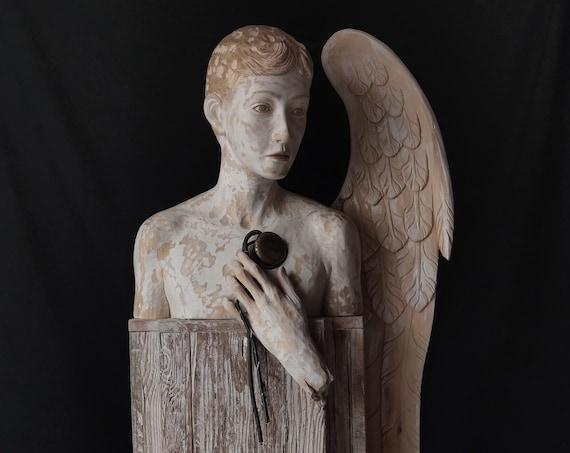 La meccanica del cuore, scultura in legno