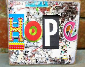 Message of 'Hope'. Graffiti inspired text design handprinted onto a wooden block 7 x 7. A postable hug x