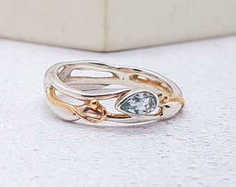 Personalized Sterling Silver Ring with Teardrop Blue Topaz Gemstone on a Silver Band with Gold Fill Detailing