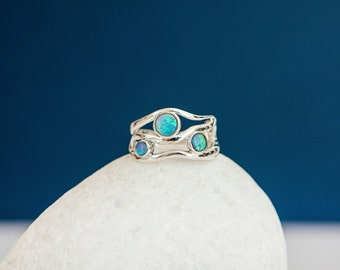 Sterling Silver Ring with Three Brilliant Blue Opal Gemstones on a Silver Band