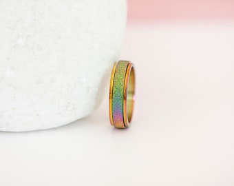 Stainless Steel Spinner Ring with Sandblasted Rainbow Finish