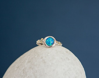 Sterling Silver Ring with Large Round Blue Opal Gemstone