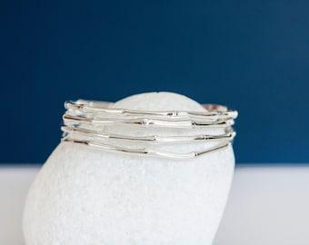 Sterling Silver Cuff Bracelet with Old Bones Design