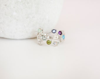 Sterling Silver Ring with Seven Small Pastel Gemstones on a Silver Band