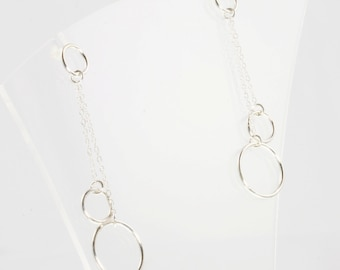 Silver earrings with two dangling rings