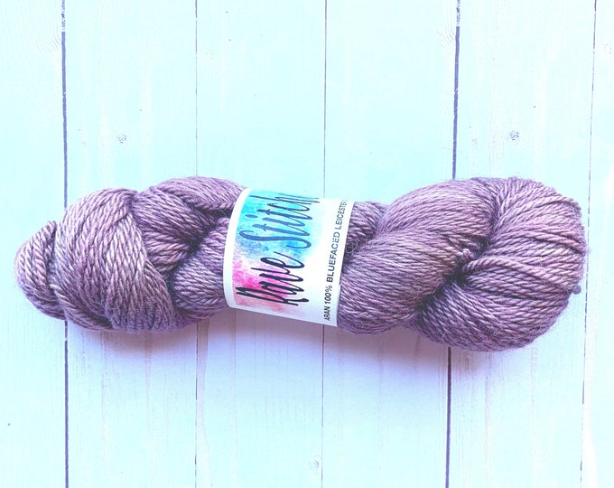 Aaron weight hand dyed super wash blue faced Leicester hand dyed yarn