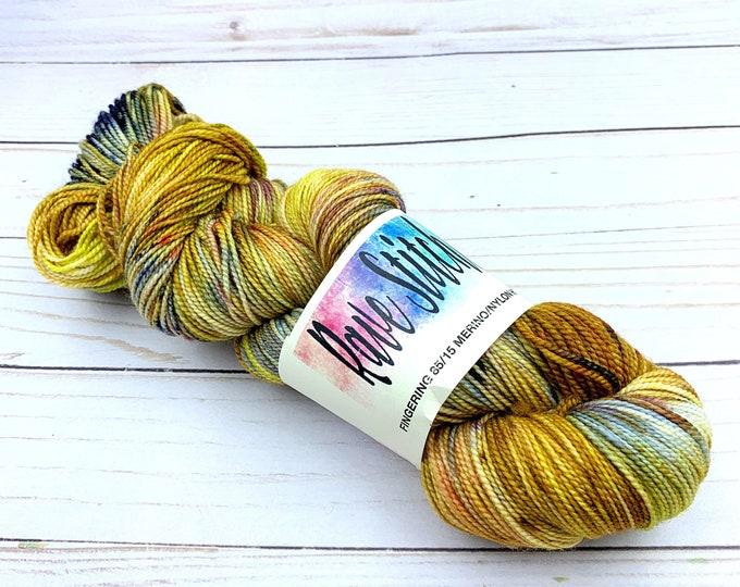 hand painted yarn 85/15 high twist, super wash  sock fingering navy, green, red, gold variegated merino nylon yarn