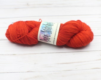 Red hand dyed 85/15 high twist, super wash  fingering merino nylon wool