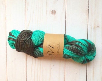 dk weight hand dyed super wash  100% merino teal green black yarn