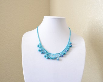Turquoise and purple crochet statement necklace