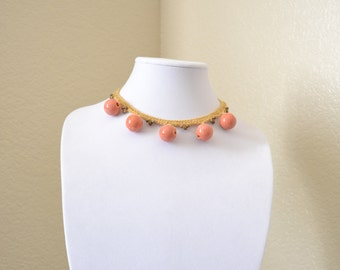 Beige and orange crochet statement necklace