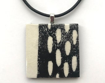 Black and white ceramic porcelain pendant with oval pattern