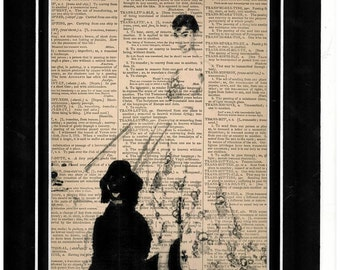 150 Audrey Hepburn holding two dogs on leash dictionary art