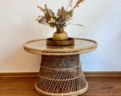 Round 70s table with a rattan frame.