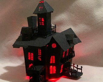You CAN make this awesome pre cut 3D Halloween Haunted House Kit! Red lights included! Fun DIY Halloween Decor