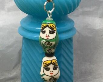 Ceramic Nesting Doll FOB: Green/White