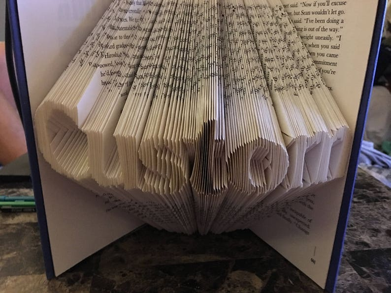 Folded book art from Etsy