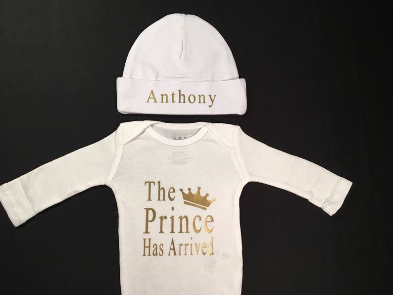 eb76f7c4f77c The Prince has Arrived Newborn Baby Onesies and Hat Set for a