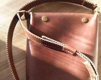 Dark Cocoa leather Messenger bag. Hand stitched strap.