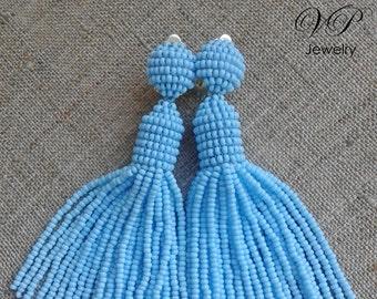 Beautiful Handmade Beaded Baby Blue Tassel Clip on Earrings in the style of Oscar de la Renta