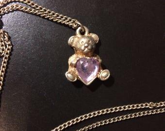 Teddy Bear holding a heart necklace
