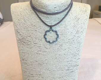grey leather wrap w/ clover pendant