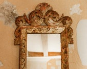 18th century French silver gilt and carved wood mirror with later glass.