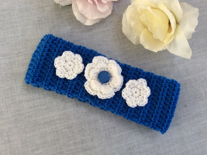 Blue crochet headband or ear warmers with flowers for baby 1 to 2 yrs