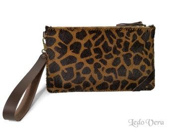 Animal print purse. Hair on leather hand bag. Animal print small hand bag
