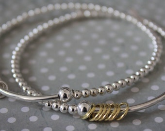 d9e66f556 Sterling Silver Noodle and Ball Bead Bracelet with Lucky Seven Rings
