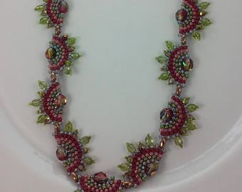 Iridescent green and red fire polished beads, rosey pink, cranberry, olive green seed beads woven in a serpentine design, beadwoven necklace