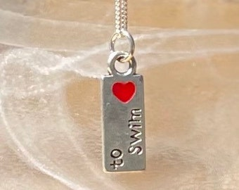 """Love to Swim charm necklace on 16"""" sterling silver chain."""