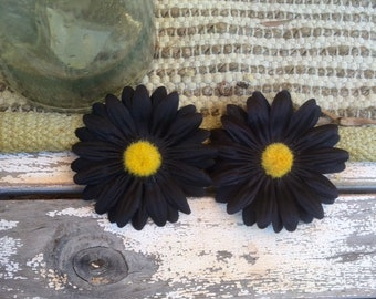 Black Daisy hair clips, sold in a set of two