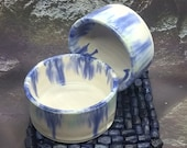 Set of two blue green white ceramic candle holders.