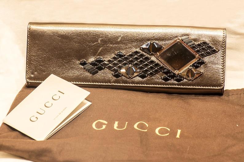 50314b6a0c4 Gucci Sleek Gold Tone Geometric Evening Clutch