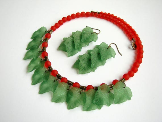 bronze wire with red beads with design charm in bronze and red beads Necklace