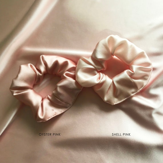 An Ivory Pleated Satin Scrunchie Ponytail Band Bobble