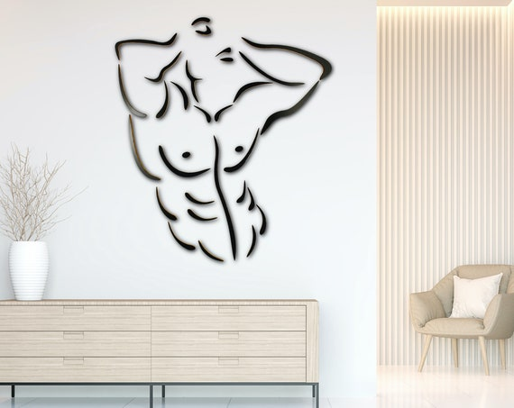 Abs: Wall mounted wood sculpture of man with well defined abdominal muscles